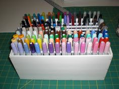 Insipiration for makeup brush holder. Flutterbug Haven: Copic Marker Case.  Made out of foam board ($ Store) and plastic light covers(Home Depot). Glued and pinned for extra strength. Measures 11.5x7.5 and holds 160 markers.