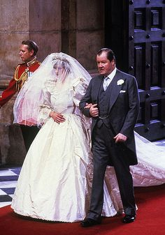 Finally Lady Diana and her father Earl Spencer proceed down the aisle.  Lovely Diana is looking a bit nervous in this photo....as any bride does but it must be 110x worse with all the world watching.