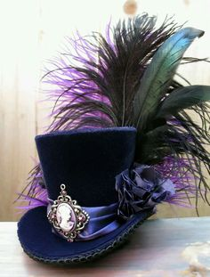 Tiny Top Hat / Mini Top Hat / Purple Velvet / Cameo / Feathers Love mini top hats, they are so awesome! Steampunk Hut, Moda Steampunk, Victorian Steampunk, Steampunk Fashion, Victorian Hats, Steampunk Necklace, Steampunk Clothing, Steampunk Top Hat, Neo Victorian