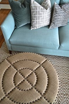 Beautiful hues, textures and patterns from Brian Paquette Interiors. Eye-catching bullseye ottoman from Jayson Home.