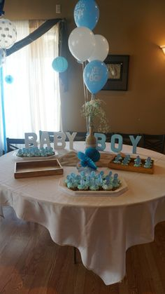Dessert table.. Baby boy cardboard letters and center piece for baby shower