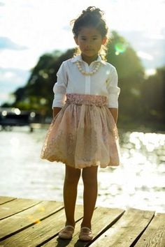 White shirt, pink and taupe lace skirt nad belt, pink pearls and shoes, undo