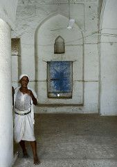Old Man Leaning Against The Wall In The Mosque, Zabid, Yemen (Eric Lafforgue Photography) Tags: people man history window vertical architecture person fan daylight construction asia day adult serious minaret muslim islam religion fulllength middleeast ground oldman indoor mosque architectural unescoworldheritagesite unesco worldheritagesite arabia historical daytime inside yemen ottoman preserved turban technique turkish oneperson preservation worldheritage onepeople craftsmanship…
