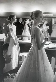 Audrey Hepburn and Grace Kelly backstage at the 28th Annual Academy Awards