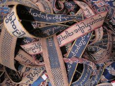 Sazigyo -- tablet-woven manuscript binding ribbons