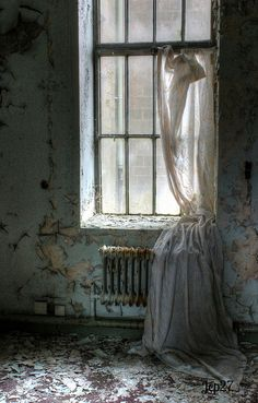 Curtains in a room in an abandoned mental hospital in the UK. Lancaster Moor Asylum.