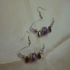 Boucles d'oreilles percées violette ref d 198