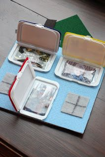 """Peek a Boo House using """"doors"""" from baby wipe containers"""