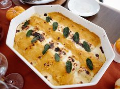 Creamy Pumpkin Lasagna Rolls : Instead of loading up on side dishes, serve Giada's substantial lasagna rolls as a non-turkey main dish. Made with creamy canned pumpkin, three cheeses and diced bacon, this satisfying and fall-inspired dish makes the Italian classic fit for the holiday table.