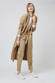 Classic trousers get a modern makeover with these belted tapered trousers. The tapered design fits high on the waist, adding a tailored look to your AW wardrobe. Tapered Trousers, Cropped Trousers, Sartorialist, Topshop Outfit, Work Wear, Fall Outfits, Duster Coat, Nordstrom, Denim