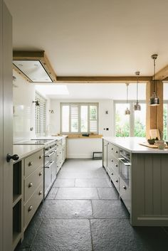 Stone flooring, simple Shaker cupboards and a beautiful Mercury range cooker