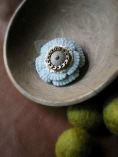 recycled wool brooch:pale blue flower brooch was made out of felted wool sweater, vintage doily, and a really unusual vintage button