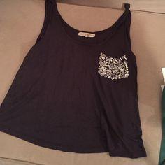 sequin pocket sleeveless top Very cute gray sequin pocket sleeveless top. Slightly a crop top Rewind Tops Tank Tops