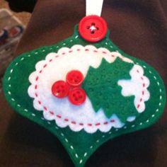 🌟Tante S!fr@ loves this 📌🌟 I used nestabilities and a holly die to cut out felt, and hand-stitched them. This one was the best seller! Felt Christmas Decorations, Christmas Ornaments To Make, Christmas Sewing, Christmas Embroidery, Handmade Christmas, Holiday Crafts, Handmade Ornaments, Felt Ornaments, Felt Gifts