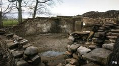 """""""Witch's cottage unearthed near Penle Hill, Lancashire"""" - The cottage was discovered near Lower Black Moss reservoir in the village of Barley, in the shadow of Pendle Hill.  Historians are now speculating that the well-preserved cottage could have belonged to one of the Pendle witches.  The building contained a sealed room, with the bones of a cat bricked into the wall.  It is believed the cat was buried alive to protect the cottage's inhabitants from evil spirits"""