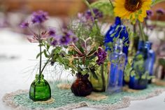 Homegrown wedding flowers in mismatched glass bottles – photography http://www.mark-tattersall.co.uk/