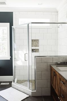 Bathroom shower wall, The semi-frameless glass shower and transom window lets light flood the rest of the bathroom. Bathroom shower wall ideas. Bathroom shower wall dimensions, Bathroom shower wall #Bathroomshowerwall #Bathroom #showerwall #showerwallideas Beautiful Homes of Instagram @thegraycottage: