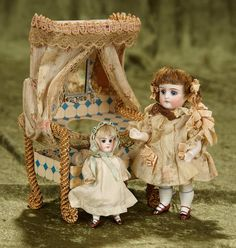 Rendezvous Auction on Wednesday, April 26th at 7PM EST. Two German all-bisque glass-eyed dolls with rare candy box as toilette table. $600/800