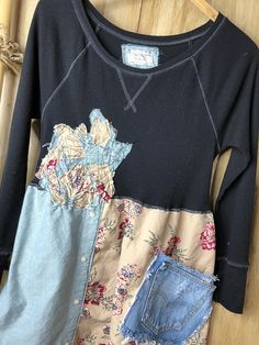 Very lightweight long sleeve knit T has a lot of give, comfortable easy to wear, shabby patchwork, pocket, and tie in back. Beautiful fabric with denim on the bottom. Can wear as a dress or tunic with jeans, clothes to live in!  Approximate measurements :  Bust area - 17 with lots