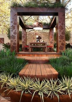 Laser cut pergola 'Flower Pad' designed for MIFGS Flower Garden Show in Melbourne 2009. Gold award. Featuring metal art & dry bed gardening