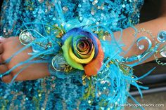 An Alvin Taylor Flowers of Paragould AR creations, this features a rainbow rose and all sorts of blue accents and feathers. This corsage perfectly compliments her sequined dress! Blue Corsage, Prom Corsage And Boutonniere, Flower Corsage, Wrist Corsage, Corsages, Boutonnieres, Homecoming Flowers, Prom Flowers, Silk Flowers