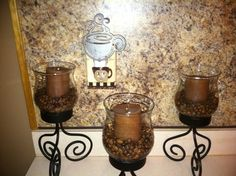 Coffee beans added to candle holders to match decor and night light put on a dusk to dawn plug....