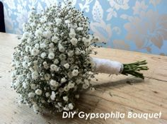 http://www.boho-weddings.com/2012/05/08/diy-tutorial-gypsophila-bouquet-and-buttonhole/ Instructions on how to make your own display