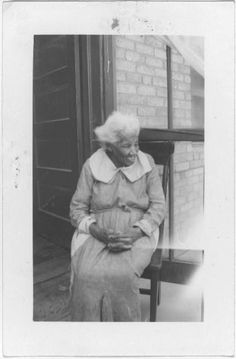 """El Paso  Mother Anne Clark , 112 years old, lives at 3602 Alameda Ave., El Paso, Texas. She is too crippled to walk, but a smile lights up the tired old eyes that still see to sew without glasses. One tooth of a third set is in her upper gum. She is deaf, but can hear if you speak close to her ear. She says, """"Lemme git my ears open, bofe of 'em,"""" wets her finger, then pulls so hard on the ex lobes it seems they would be injured."""
