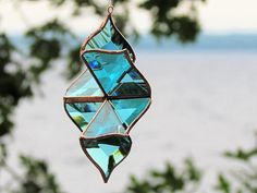 NEW from SNL Creations Turquoise Stained Glass Flower Suncatcher Sculptural Turquoise Stained Glass Flower Ornament 5.25x5.25x2 (13x13x5cm) *** Available only while supplies last *** New - Same sculptural design as the 3d star, now available in a lovely new flower shape. Original and