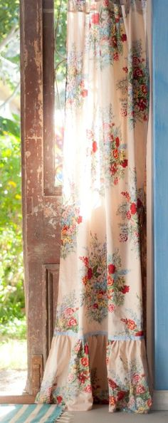 Lovely old door with pretty floral curtain. Very shabby chic.