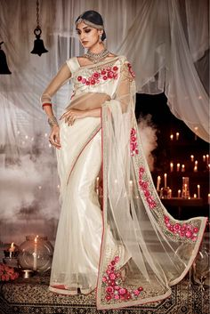 Off White Colour Net Fabric Wedding Wear Designer Saree Comes With Matching Net Fabric Blouse. This Saree Is Crafted With Cut Dana,Mirror Work,Moti Work,Hand Work,Embroidery. This Saree Comes With Uns...