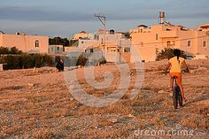 Bedouin Girl On A Bicycle Near Houses In The Negev Desert, Israel - Download From Over 57 Million High Quality Stock Photos, Images, Vectors. Sign up for FREE today. Image: 71349383