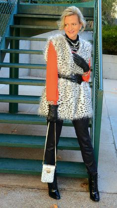 Jamie from More Than Turquoise sports a faux fur vest and statement jewelry.
