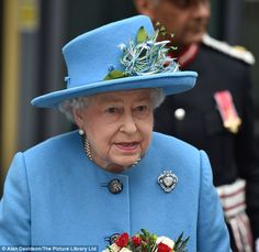 Carrying a beautiful bouquet of red and white roses, the Queen accessorised her look with ...