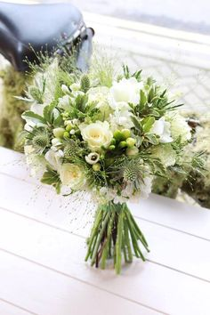 Simple Cream and Green bridal bouquet with soft flowers and various foliage. Made by Stems, Innerleithen.