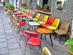"would be neat in a modern setting with neutral colors - let the chairs be the ""pop"""