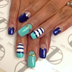 blue and teal nail art with stripes