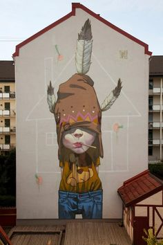 ETAM CREW  Street-art Fresque murale XXL. ETAM Cru, un Street art en provenance des pays de l'Est. Issu du mouvement Graffiti et Street art, les artistes polonais SAINER et BEZT  originaires de Łódź et Turek en Pologne ont fondé le Crew : ETAM Cru. Diplômés en 2010 de l'Académie des Beaux-Arts de Łódź, ils travaillent comme artistes free-lance à Varsovie (Pologne)