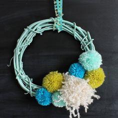 Spring up your décor this DIY Pom Pom Wreath!