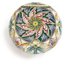 A RUSSIAN SILVER AND SHADED ENAMEL PILL BOX, FEDOR RÜCKERT, MOSCOW, 1899-1908 of circular cushion form, with polychrome cloisonné enamel foliage Diameter 1 3/4 in.; 4.5 cm flower