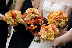Bouquets in fall colors.  I like the idea of deep purple bridesmaids dresses with lighter colored bouquets and darker, purple and red flowers in the bride's bouquet.
