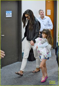 Katie Holmes arrives on a flight at LAX Airport with her daughter Suri on July 21, 2013