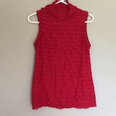 NY Collection Red sleeveless top NY Collection red sleeveless ruffle top. Mock turtle neck style neck. Cute and fun to wear. A favorite. In good condition. No stains or rips. Small snag on back of top. See picture. Size Large. NY Collection Tops