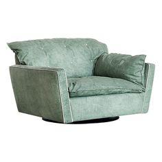 Кресло Sorrento,  диз. П. Навоне, Baxter.   Модель на скрытом   каркасе. Обивка —   кожа, спинка украшена   декоративной стежкой