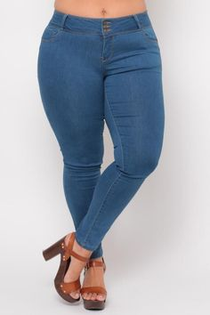This plus size, stretchy skinny jeanfeatures a high 3 button waist,five-pocket construction, a zipper fly, push up denim technology to lift your butt in all the right places, contoured curves, sculpted silhouette, and a tapered leg.  Content + Care 75% Cotton 23% Polyester 27% Spandex Machine wash cold  ModelMeasu