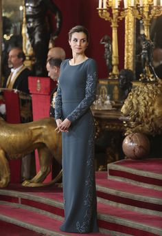 Queen Letizia of Spain looked ethereal at a military ceremony in Madrid in a figure-skimming, floor-length blue gown with embroidery as she returned to royal duties after the festive break