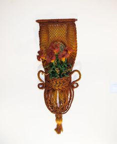 Hey, I found this really awesome Etsy listing at https://www.etsy.com/listing/186076548/macrame-wall-hanging-basket-of-lilies