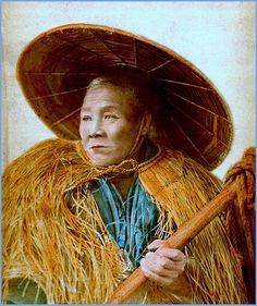 THE FARMER. A Portrait from Old Japan in 1873.  Attributed to SHINICHI SUZUKI, a disciple of pioneering Japanese photographer RENJO SHIMOOKA, it was not taken in an indoor studio. Rather, it was taken in an outdoor setting,