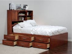 The Queen Raised Panel Storage bed with 12 Drawers, offers under bed storage with 12 large drawers on full extension tracks to help you utilize your space. The drawers feature solid birch raised panel faces which adds elegance and durability to your piece. No box spring is required on our Storage beds. The bed comes in three fully assembled pieces. #storage #bedroom #realwood #bed #smallspace #nycliving #gothicfurniture