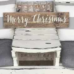 Christmas Wall Decor - Merry Christmas - Wooden Sign - Rustic Sign - Farm House - Christmas. This is a hand painted sign on pine board. It's shown here with a dark walnut stained background and letters in ivory. There is a saw tooth hanger attached to the back if you'd like to hang it or you can prop it up on a shelf. A protective clear coat is applied to the finished product to protect your piece for years to come. I make no attempt to cover any knots or imperfections- they give your sign…